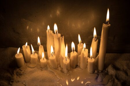 Candles in night on snow. Creative artwork decoration. Selective focus. Empty space for your text Stockfoto