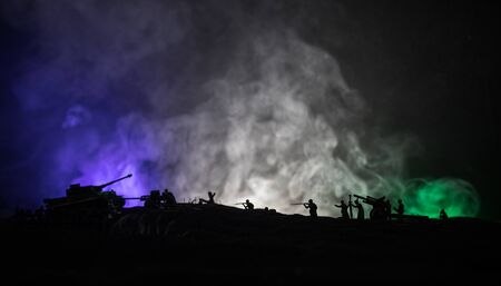War Concept. Military silhouettes fighting scene on war fog sky background. Attack scene. Armored vehicles and infantry. Creative composition