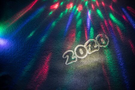 2020 written on the snow. Happy new 2020 year. Empty space for your text. Holiday party poster concept. Artwork decoration