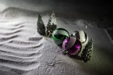 Winter holidays concept. Christmas background with baubles, on snow, free space for text. Christmas decoration. Festive background. Empty space for text Banco de Imagens