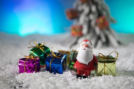 decorative cute brown rat around with a Christmas decor and Santa Claus. The rat is a symbol Of the new year 2020 Foto de archivo