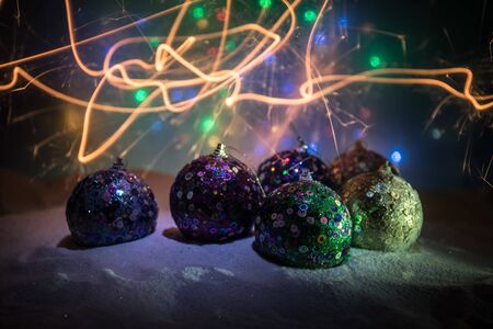 Winter holidays concept. Christmas background with baubles, on snow, free space for text. Christmas decoration. Festive background. Empty space for text Stock fotó