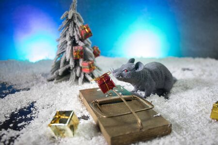 decorative cute brown rat around with a Christmas decor and Santa Claus. The rat is a symbol Of the new year 2020 Stock fotó