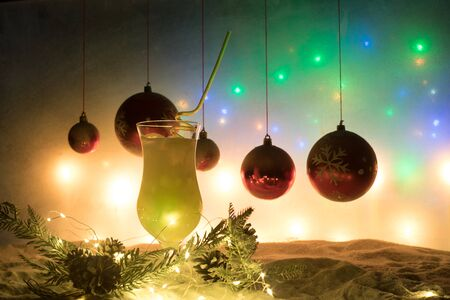 New Year and Christmas party concept. Different tasty cocktails with creative New Year holiday artwork decoration on background. Colorful cocktail in glass. Party club entertainment. Copy space. Stock fotó