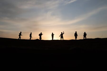 War Concept. Military silhouettes fighting scene on war fog sky background, World War Soldiers Silhouette Below Cloudy Skyline sunset. Selective focus Stok Fotoğraf