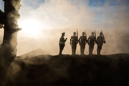 War Concept. Military silhouettes fighting scene on war fog sky background, World War Soldiers Silhouette Below Cloudy Skyline At sunset. Battle in ruined city. Selective focus Stok Fotoğraf