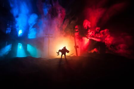 Silhouette of a man carrying injured girl from fire. Rescue savior concept. Military officer running out with woman from burned out city destroyed in war. Creative artwork decoration. Selective focus Standard-Bild