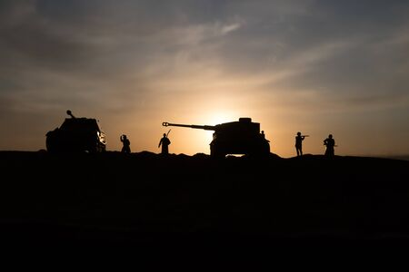 War Concept. Military silhouettes fighting scene on war fog sky background, World War Soldiers Silhouette Below Cloudy Skyline sunset. Selective focus 스톡 콘텐츠