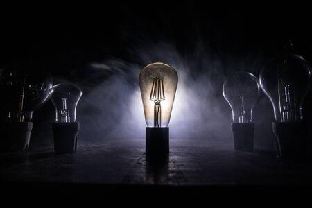Beautiful retro luxury light lamp decor glowing. Abstract dark background with creative artwork decoration of glowing bulbs. 写真素材