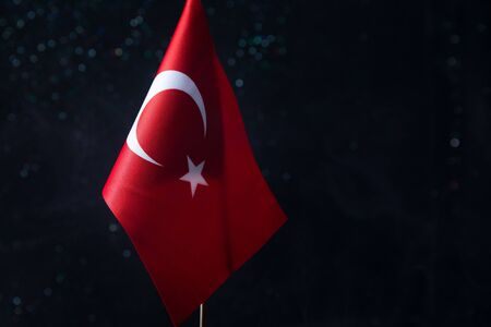 Turkey small flag on dark background. Concept of crisis of war and political conflicts between nations. Selective focus