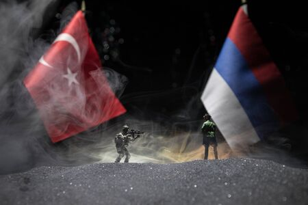 Russia and Turkey small flag on dark background. Concept of crisis of war and political conflicts between nations. Selective focus