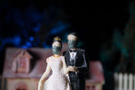 Miniature people : Happy bride wearing masks to protect against viruses during wedding time. People wear masks to prevent New type pneumonia.