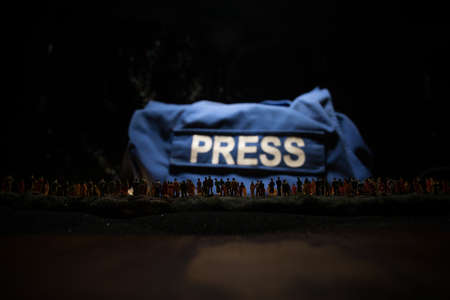 Media Journalism fake news concept. Crowd looking on giant PRESS word. Puppeteer controls media and people. Selective focus 版權商用圖片