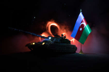 Azeri army concept. Silhouette of armored vehicle against Azerbaijani flag. Creative artwork decoration. Military silhouettes fighting scene dark toned foggy background. Selective focus