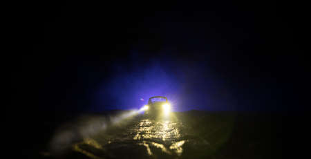 Fog on the Road. Extreme Driving Conditions. Foggy Road Ahead. Car miniature. Selective focus