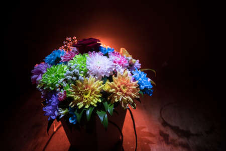 Beautiful and colorful flower bouquet, on dark bakground. Floral bouquet of different flowers. Best for a greeting card. Selective focus Archivio Fotografico - 158165523