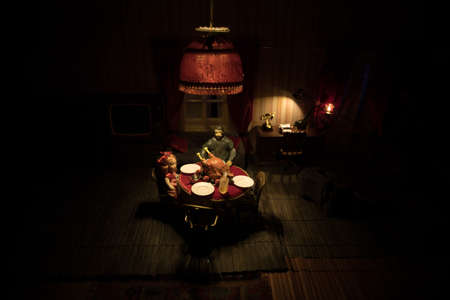 Thanksgiving holiday creative concept. A realistic dollhouse living room with furniture and window at night. Thanksgiving Turkey miniature on table. Selective focus Archivio Fotografico - 158165536