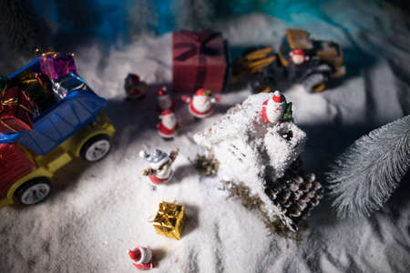 Miniature Gift Box by Forklift Machine on snow, Determined Image for Christmas Holiday and Happy New Year Gift Celebration concept. Empty space for text Archivio Fotografico - 158165538