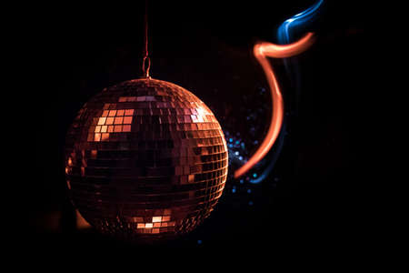 Colorful disco mirror ball lights night club background. Party lights disco ball. Selective focus Archivio Fotografico - 158165558