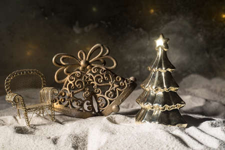 Christmas decorations. Golden Fir tree standing with beautiful holiday decorated background and traditional holiday attributes. Selective focus. Empty space for your text Archivio Fotografico - 158165560