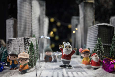Little miniature city with road and lights. Decorative cute small houses in snow at night in winter. Creative Holiday concept. Christmas and New Year attributes decorated composition. Archivio Fotografico - 158165570