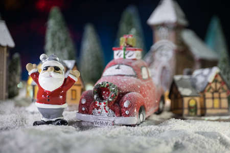 Christmas and New Year holidays concept. Little decorative cute small houses in snow at night. Traditional holiday attributes on snow. Creative artwork decorations. Empty space for your text Archivio Fotografico - 158165585