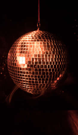 Colorful disco mirror ball lights night club background. Party lights disco ball. Selective focus