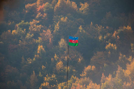 Azerbaijan flag, Waving flag on the mountain. National flag of Azerbaijan on strong wind in the sunny day. Outdoor nature shot Stock fotó