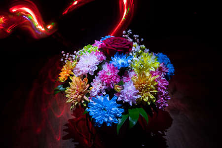 Beautiful and colorful flower bouquet, on dark bakground. Floral bouquet of different flowers. Best for a greeting card. Selective focus