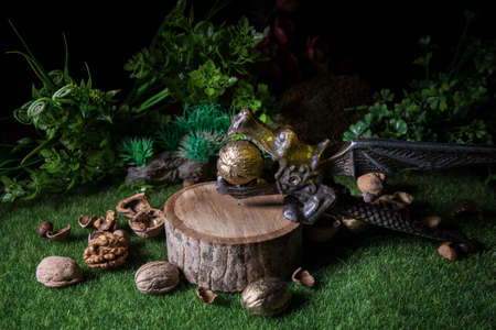 Still life with Walnut kernels and whole walnuts on green grass Creative table decoration. Closeup. Selective focus Archivio Fotografico