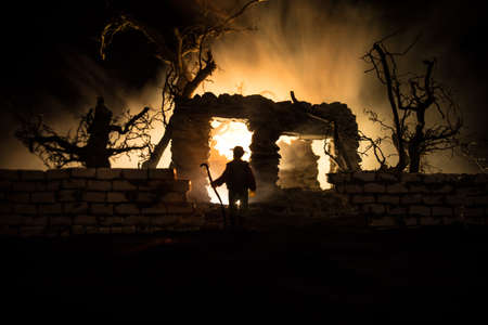 Old stone house burning uncontrollable in the night. A fire in a country house. Creative artwork decoration. Selective focus