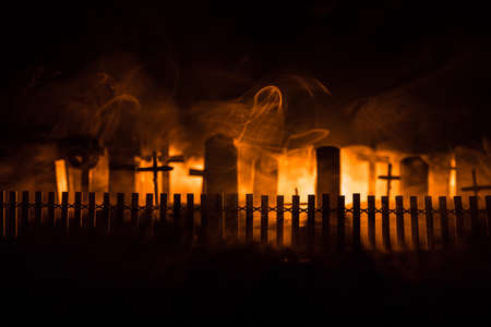 Scary view of zombies at cemetery with cloudy sky and fog, Horror Halloween concept. Selective focus