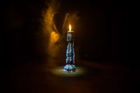 Single burning candle. Light of flame and flowing candle wax, dark background. Selective focus Stock fotó