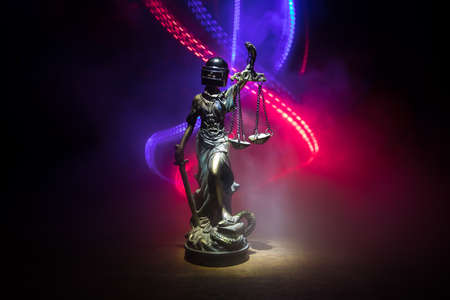 No law or dictatorship concept. The Statue of Justice with anti-riot police helmet holding scale. Creative artwork decoration with colorful toned foggy background. Selective focus