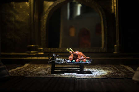 A realistic Arabian interior miniature with window and columns. Meals are served before sunrise called Suhur. Festive greeting card, invitation for Muslim holy month Ramadan Kareem. Selective focus Фото со стока