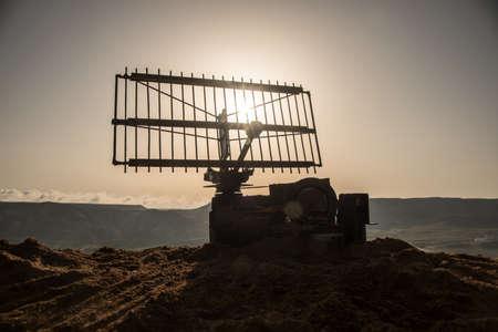 Space radar antenna on sunset. Silhouettes of satellite dishes or radio antennas against night sky. Creative artwork decoration. Selective focus Фото со стока