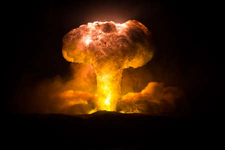 Nuclear war concept. Explosion of nuclear bomb. Creative artwork decoration in dark. Selective focus Banque d'images