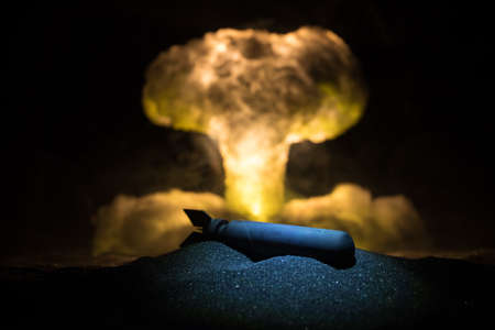 Nuclear war concept. Explosion of nuclear bomb. Creative artwork decoration in dark. Selective focus