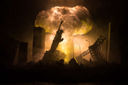 Nuclear war concept. Explosion of nuclear bomb. Apocalyptic view of city downtown after bombing. Night scene. City destroyed by war.