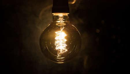 Beautiful retro luxury interior bulb lighting lamp decor glowing in dark. Selective focus Archivio Fotografico