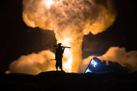 Military soldier silhouette with bazooka. War Concept. Military silhouettes fighting scene on war fog sky background, Soldier Silhouette aiming to the target at night. Attack scene