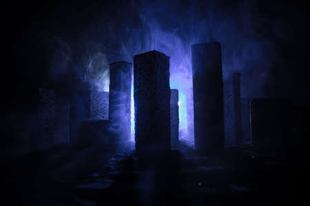 Empty street of burnt up city, flames on the ground and blasts with smoke in the distance. Apocalyptic view of city downtown as disaster film poster concept. Night scene. City destroyed by war.