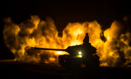 War Concept. Military silhouettes fighting scene on war fog sky background, World War Soldiers Silhouette Below Cloudy Skyline At night. Tank battle. Selective focus Imagens
