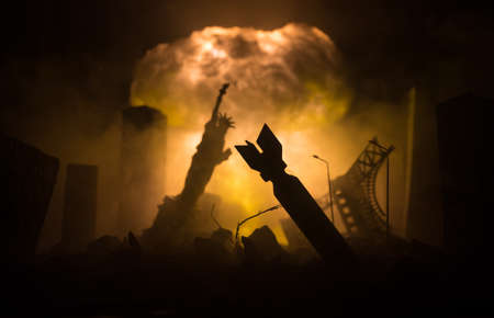 Nuclear war concept. Explosion of nuclear bomb. Apocalyptic view of city downtown after bombing. Night scene. City destroyed by war. Stock Photo