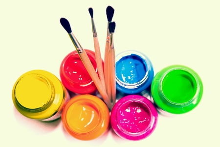 bright: Set for painting on a white background, brush, bright gouache in jars. Stock Photo