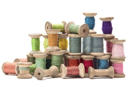 wooden spools with colored cotton threads for sewing, vintage 스톡 콘텐츠