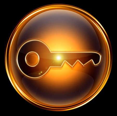 Key icon gold, isolated on black background photo