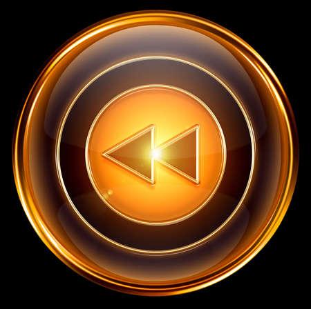 Rewind Back icon gold, isolated on black background Stock Photo - 6173139