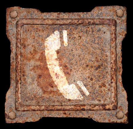 Phone icon old metal, isolated on black background photo