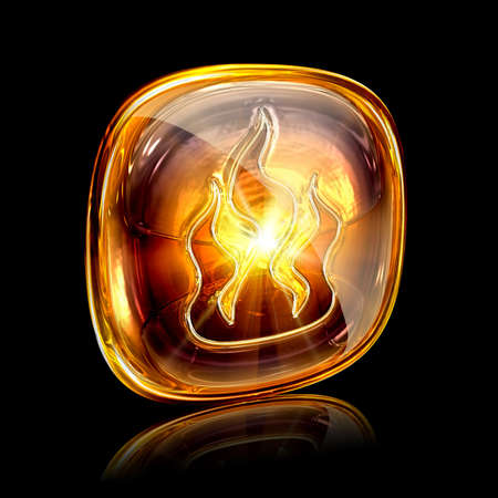 fire icon amber, isolated on black background photo